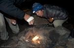 stoking a campfire