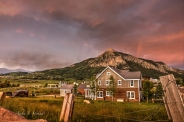 lightning and rainbow over crested butte