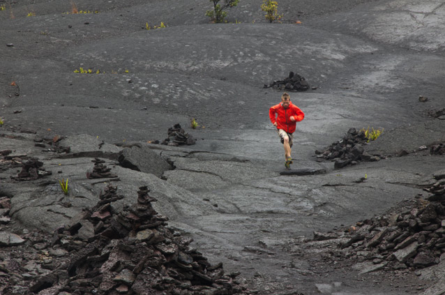 Brandon snapped this shot of me running across the caldera through rain and sulfur steam on the Kilueau Iki trail.